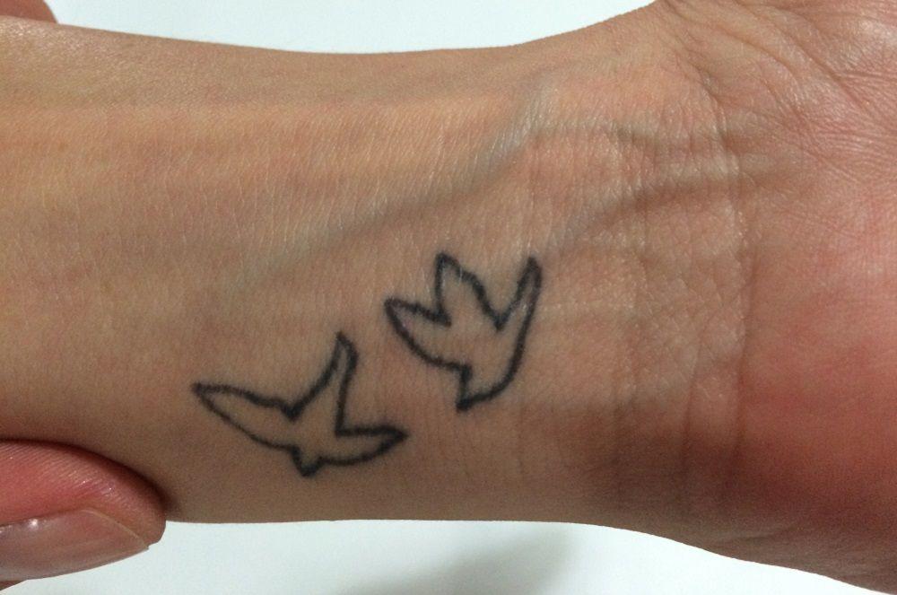 Tatuaje de un pequeño pájaro
